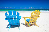 Colorful chairs on beach — Stock Photo