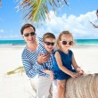 Father and two kids on palm — Stock Photo