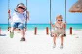 Little kids swinging — ストック写真