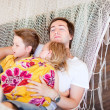 Father and his kids relaxing in hammock — Stock Photo #5944549