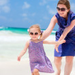 Mother and daughter running at beach — Stock Photo #5944706