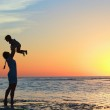 Family at sunset — Stock Photo #5944740