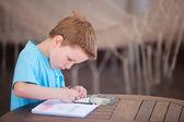 Boy drawing or writing — Stock Photo