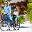 Father and son on bike - Stock Photo