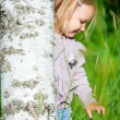 Little girl outdoors at summer day — Stock Photo