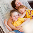 Father and his kids relaxing in hammock — Stock Photo #6118635