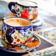 Cappuccino served in colorful cups - Stok fotoğraf