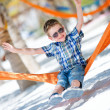 Happy boy sitting in hammock — Stock Photo #6118837