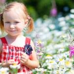 Little girl in meadow — Stock Photo