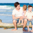 Stock Photo: Family enjoying evening by the sea