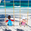 Stock Photo: Little kids swinging