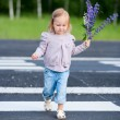 Little girl crossing road - Stock Photo