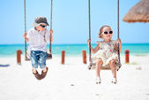 Little kids swinging — Stock Photo