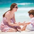 Stock Photo: Mother and son at beach