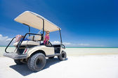 Golf cart at tropical beach — Stock Photo