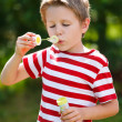 Blowing soap bubbles - Stock Photo