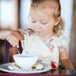 Stock Photo: Girl eating breakfast