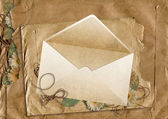 Envelope on the background of torn paper — Stock Photo
