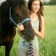 Girl and horse — Stock Photo #6291099