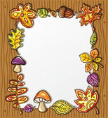 Vector frame with autumnal nature symbols — Stock Vector