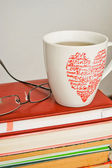 Pile of old books, glasses and a cup of tea — Stock Photo