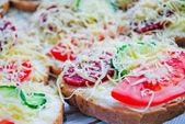 Snack: sliced bread with fresh vegetables, mayonnaise and cheese — Stock Photo