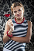 Girl with a sweet heart-shaped — Stock Photo