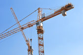 Tall yellow tower crane — 图库照片