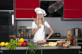 Girl chef in the kitchen — Stock Photo