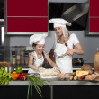 Mom teaches daughter to cook — Stock Photo