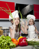 Two little girl cook — Stock Photo