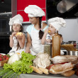 Mother and two daughters in the kitchen — Stockfoto #5923733