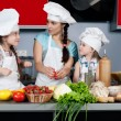 Royalty-Free Stock Photo: Mother and two daughters in the kitchen