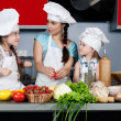 Mother and two daughters in the kitchen — Stock Photo #5923762