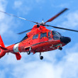 Red rescue helicopter moving in blue sky — Stock Photo #6060142