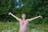 Pregnant woman with open hands — Stock Photo
