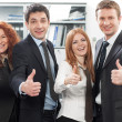 Stock Photo: Team express positivity in office