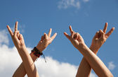 Hands rised up in air across sky — Stock Photo