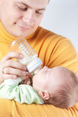 Father nurse new born baby — Stock Photo