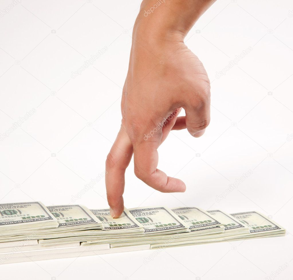Man hand run on stairs from one hundred dollar bills — Stock Photo #5750973