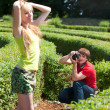 Stock Photo: Photographer with models in park