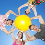 Hold yellow ball across sky — Stock Photo #5888383