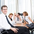 Manager with office workers in board room — Stock Photo #5888495