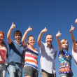 Raise hands across blue sky — Stock Photo #5888531