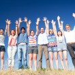 Raise hands across blue sky — Stock Photo #5888555