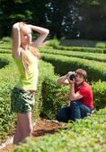 Photographer with models in park — Stock Photo