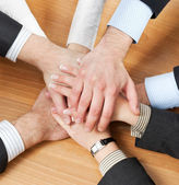 Workers hold hands together — Stock Photo