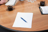 Pen and paper on table — Stock Photo