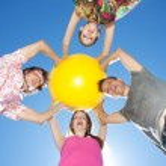 Hold yellow ball across sky — Stock Photo #5893047