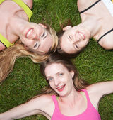 Girls on grass express positivity — Stock Photo